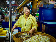 10 JULY 2018 - NAKHON PATHOM, THAILAND:  A woman in the Nakhon Pathom market sells bean sprouts. Nakhon Pathom is about 35 miles west of Bangkok. It is one of the oldest cities in Thailand, archeological evidence suggests there was a settlement on the site of present Nakhon Pathom in the 6th century CE, centuries before the Siamese empires existed. The city is widely considered the first Buddhist community in Thailand and the nearly 400 foot tall Phra Pathom Chedi is considered the first Buddhist temple in Thailand.    PHOTO BY JACK KURTZ