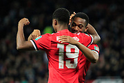 Manchester United striker Marcus Rashford (19) celebrates scoring a goal (1-0) with team-mates during the EFL Cup match between Manchester United and Burton Albion at Old Trafford, Manchester, England on 19 September 2017. Photo by Richard Holmes.