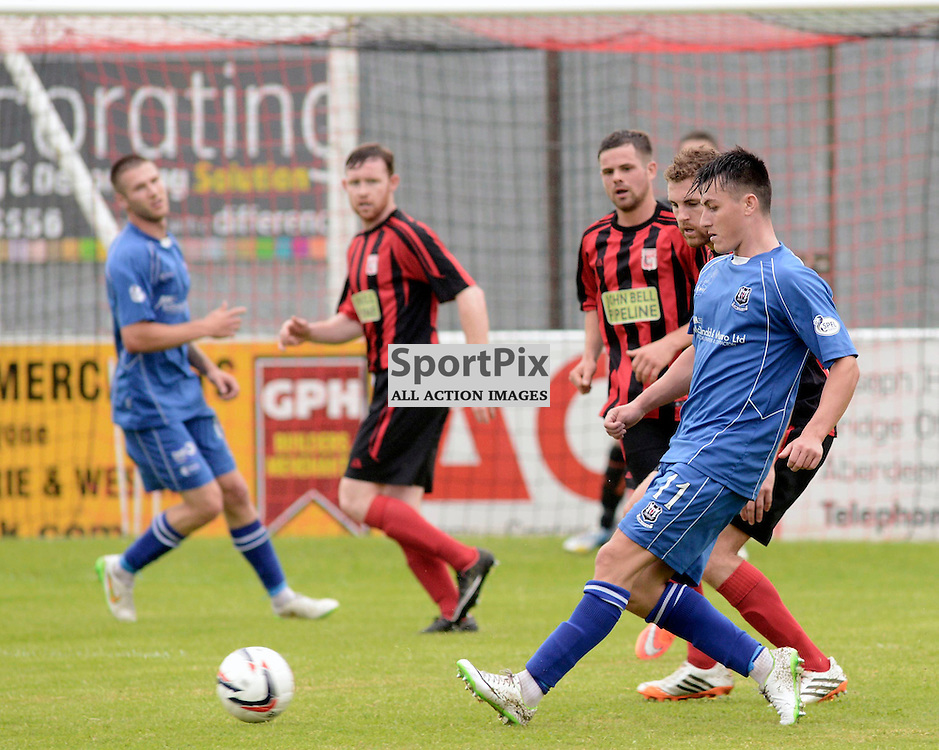 Archie McPhee (Blue shirt) sets up an attack for Elgin City.<br /> Inverurie Loco Works FC v Elgin City, Friendly, 4 Juy 2015<br /> (C) Maurice Morwood | SportPix.org.uk