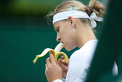 LONDON, ENGLAND - Monday, June 24, 2013: Lucie Safarova (CZE) eats a banana during the Ladies' Singles 1st Round match on day one of the Wimbledon Lawn Tennis Championships at the All England Lawn Tennis and Croquet Club. (Pic by David Rawcliffe/Propaganda)