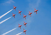 Red Arrows aerobatic team in flying formation over RAF Scampton, Lincolnshire, UK in BAE Systems Hawk T1 aircraft with Rolls Royce engine