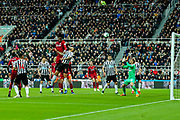 Divock Origi (#27) of Liverpool scores Liverpool's third goal (2-3) with a header from a free kick during the Premier League match between Newcastle United and Liverpool at St. James's Park, Newcastle, England on 4 May 2019.