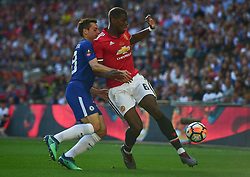 Paul Pogba of Manchester United battles for the ball with Cesar Azpilicueta of Chelsea - Mandatory by-line: Alex James/JMP - 19/05/2018 - FOOTBALL - Wembley Stadium - London, England - Chelsea v Manchester United - Emirates FA Cup Final