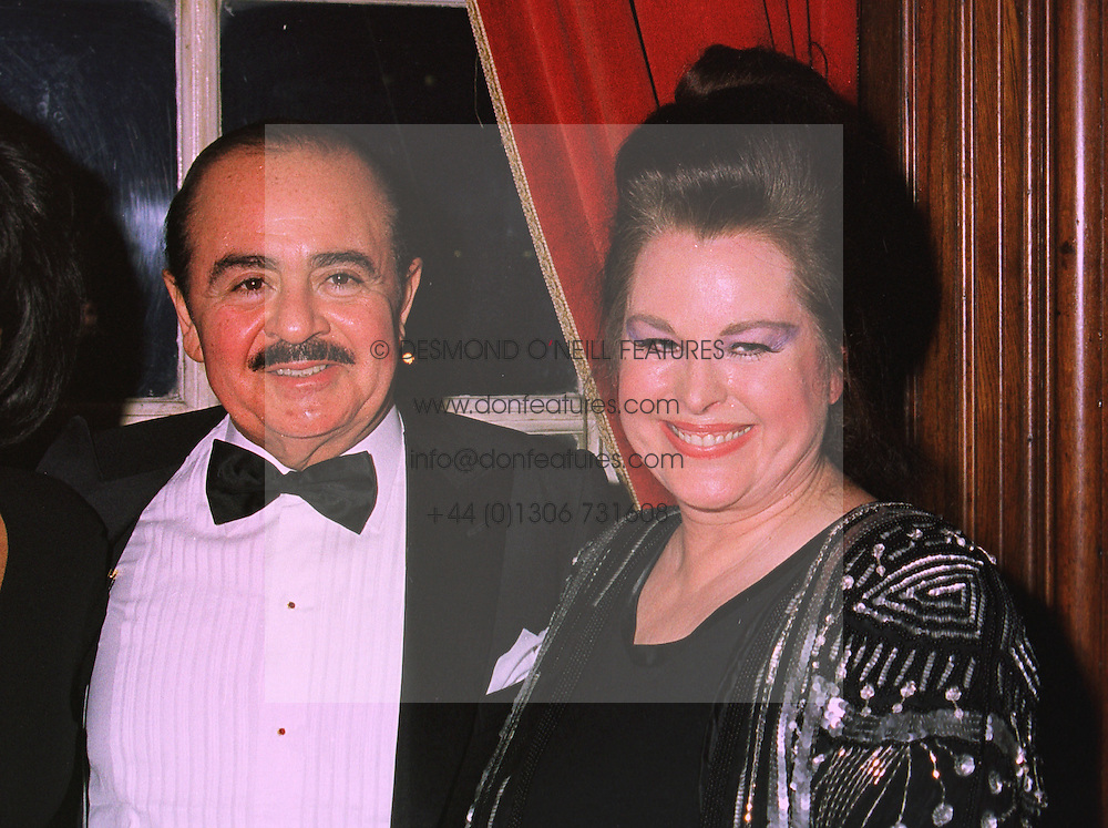 Middle Eastern arms dealer MR ADNAN KHASHOGGI and his former wife MRS SORAYA KHASHOGGI. at a wedding in London on 6th December 1997. MED 95