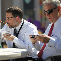 Payne Atkinson, left, of BancorpSouth enjoys a bowl of chili at Friday Chilifest cook-off Friday afternoon in downtown Tupelo.