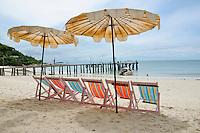 Tropical beach chairs and umbrellas, Koh Samet, Thailand