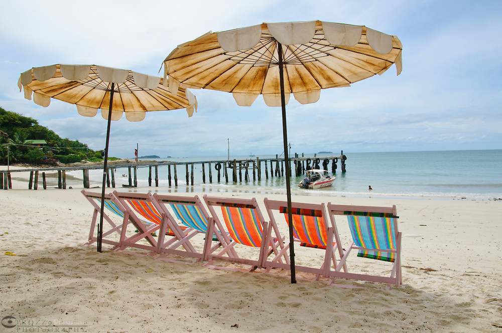 Tropical beach chairs and umbrellas, Koh Samet, Thailand
