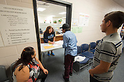 Staff assist with registration of new students in preparation for the first day of school at Chavez High School, August 20, 2014.