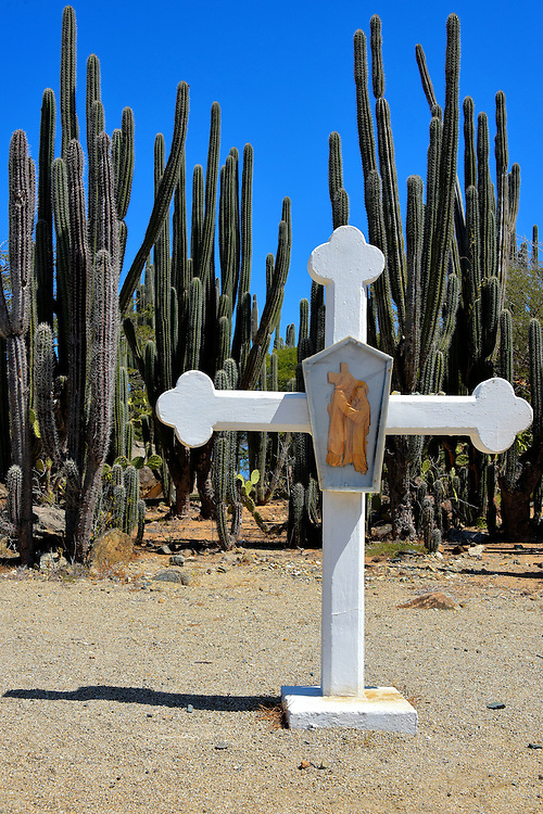 Station of the Cross Near Noord, Aruba <br /> Thirteen white crosses mark the dusty, winding road leading up to the final cross at Alto Vista Chapel. Local Catholics often walk this path while praying at each of the Stations of the Cross. This tradition has earned the tiny church the nickname &ldquo;Pilgrims Church.&rdquo;  This is the Fourth Station: Jesus meets his mother.