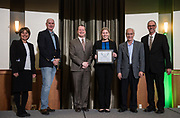 Sarah Petrie holds her Award of Excellence with judges at the 3rd Annual Robert L. Foehl Ethical Leadership Case Competiton.
