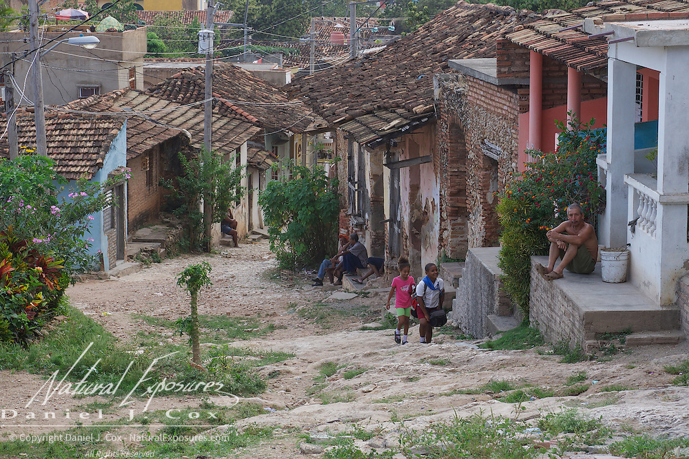 Locals on the streets far from the tourists area in Trindidad,  Cuba
