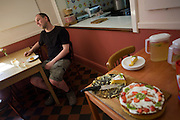 After meal talk for the Buddhist monk Nagasiddhi in dining room at the Rivendell Buddhist Retreat Centre, England.