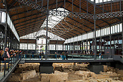 Mercat, Mercado del Born, Barcelona, a former public market, now a museum and cultural space. Designed by Antoni Rovira i Trias and built 1874-1878 by  Josep Fontserè i Mestre and engineer Josep Maria Cornet i Mas. It was the principal city market until 1971, and was later restored, between 1977 and 1981. The floor is now open to display the medieval city ruins below.