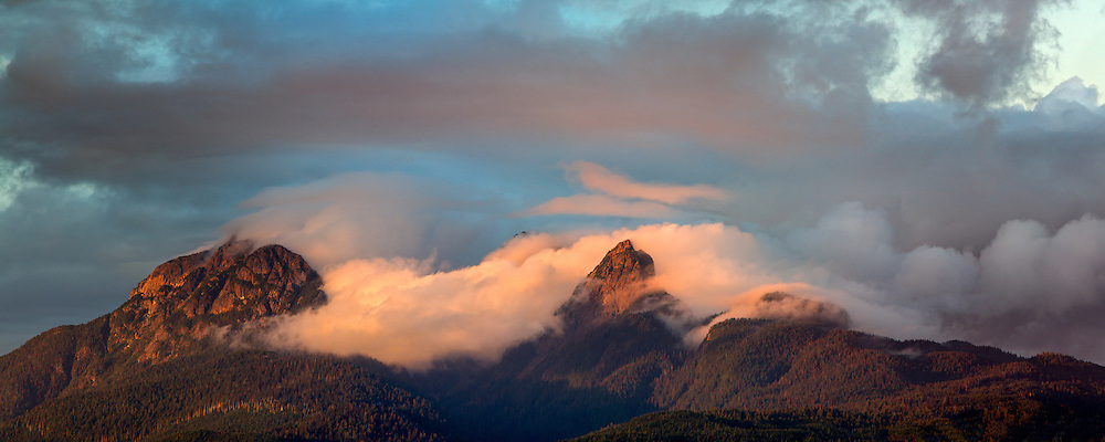 Sunset light hits the clouds clearing from Mount Blandshard (The Golden Ears) - photographed from Tavistock Point at Brae Island Regional Park in Langley, British Columbia, Canada