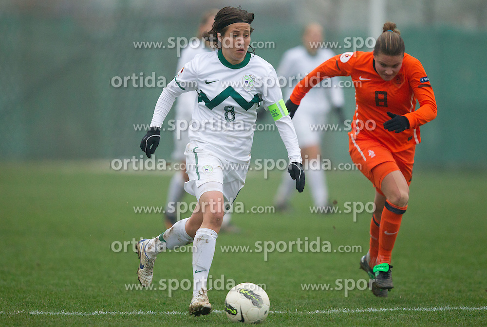 Mateja Zver of Slovenia vs Sherida Spitse of Netherlands during football match between Women national teams of Slovenia and Netherlands in 4th Round of EURO 2013 Qualifications, on November 19, 2011 in Ivancna Gorica, Slovenia. Netherlands defeated Slovenia 2-0. (Photo By Vid Ponikvar / Sportida.com)