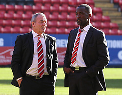 Charlton Athletic Manager, Chris Powell discusses the state of the pitch with ex player and football adviser Keith Peacock- Photo mandatory by-line: Robin White/JMP - Tel: Mobile: 07966 386802 11/01/2014 - SPORT - FOOTBALL - The Valley - Charlton - Charlton Athletic v Barnsley - Sky Bet Championship