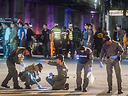 Aug. 17, 2015 - Bangkok, Thailand - <br /> <br /> Huge Explosion Rocks Bangkok Landmark<br /> <br />  Thai police scour the street in front of Erawan Shrine for evidence after a large explosion at the shrine. An explosion at Erawan Shrine, a popular tourist attraction and important religious shrine, in the heart of the Bangkok shopping district killed at least 19 people and injured more than 120 others, mostly foreign tourists, during the Monday evening rush hour. Twelve of the dead were killed at the scene. Thai police said an Improvised Explosive Device (IED) was detonated at 18.55. Police said the bomb was made of more than six pounds of TNT stuffed in a pipe and wrapped with white cloth. Its destructive radius was estimated at 100 meters. The Bangkok government announced that public schools would be closed Tuesday as a precaution. <br /> ©Exclusivepix Media