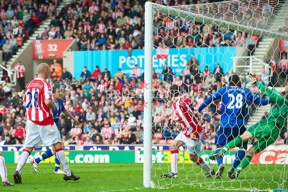 STOKE, ENGLAND - Saturday, May 1, 2010: Everton's Victor Anichebe pushes Stoke City's goalkeeper Asmir Begovic which resulted in his side's only goal being disallowed during the Premiership match at Britannia Stadium. (Photo by David Rawcliffe/Propaganda)