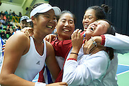 INOWROCLAW, POLAND - 2016 APRIL 17: Ching-Wen Hsu of Chinese Taipei celebrates with teammates her! victory at fourth women's singles during the Fed Cup / World Group Play Off round tennis match between Poland and Chinese Taipei at OSiR Hall on April 17, 2016 in Inowroclaw, Poland.<br /> <br /> Picture also available in RAW (NEF) or TIFF format on special request.<br /> <br /> Any editorial, commercial or promotional use requires written permission.<br /> <br /> Adam Nurkiewicz declares that he has no rights to the image of people at the photographs of his authorship.<br /> <br /> Mandatory credit:<br /> Photo by © Adam Nurkiewicz / Mediasport