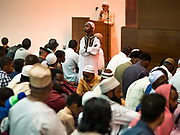 04 JUNE 2019 - DES MOINES, IOWA: A boy stands up in the crowd just before Eid al Fitr services in the Iowa Events Center in Des Moines Tuesday. About 3,000 people were expected to attend the annual community wide celebration of Eid al Fitr which marks the end of Ramadan, the Muslim month of fasting. According to the event organizers, there are about 15,000 Muslims in the Des Moines area.           PHOTO BY JACK KURTZ