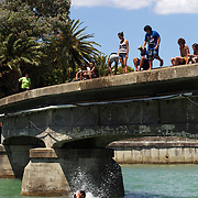 Youngsters jump off the bridge near the Waka Sculpture at end of Gladstone Rd .New Zealand,, 2010. Photo Tim Clayton.