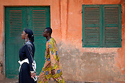 Porto-Novo March 2006 - People walk in front a typical house in Porto-Novo, Benin. © Jean-Michel Clajot