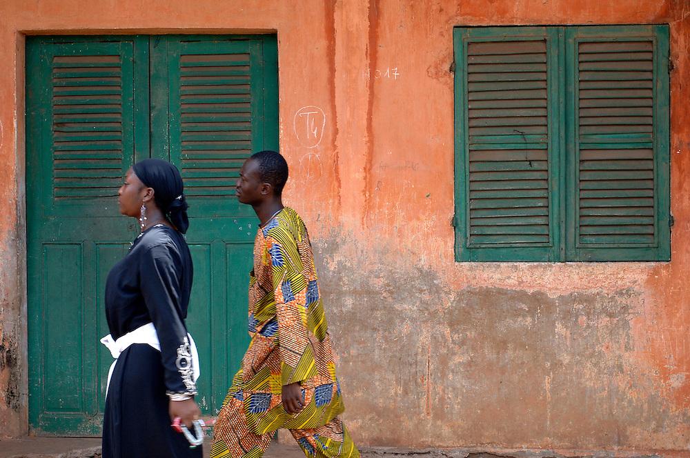 Porto-Novo March 2006 - People walk in front a typical house in Porto-Novo, Benin. © Jean-Michel Clajot