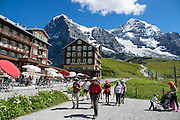 "Kleine Scheidegg pass. We walked downhill from Eigergletscher train station (of the Jungfraujoch ""Top of Europe"" railway) under the north face of the Eiger (3970m / 13,020 ft elevation) to Alpiglen station in Grindelwald Valley, Canton of Bern, Switzerland, the Alps, Europe. The Eiger has the biggest north face in the Alps: 1800 vertical meters (or 5900 ft) of rock and ice. The Swiss Alps Jungfrau-Aletsch region is honored as a UNESCO World Heritage Site.The Swiss Alps Jungfrau-Aletsch region is honored as a UNESCO World Heritage Site. For licensing options, please inquire."