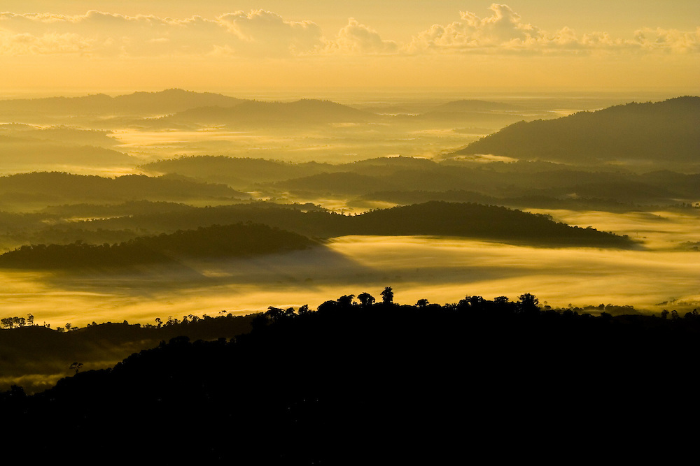 Clouds nestle among the forested ridges of Serra Bonita in Bahia State, Brazil