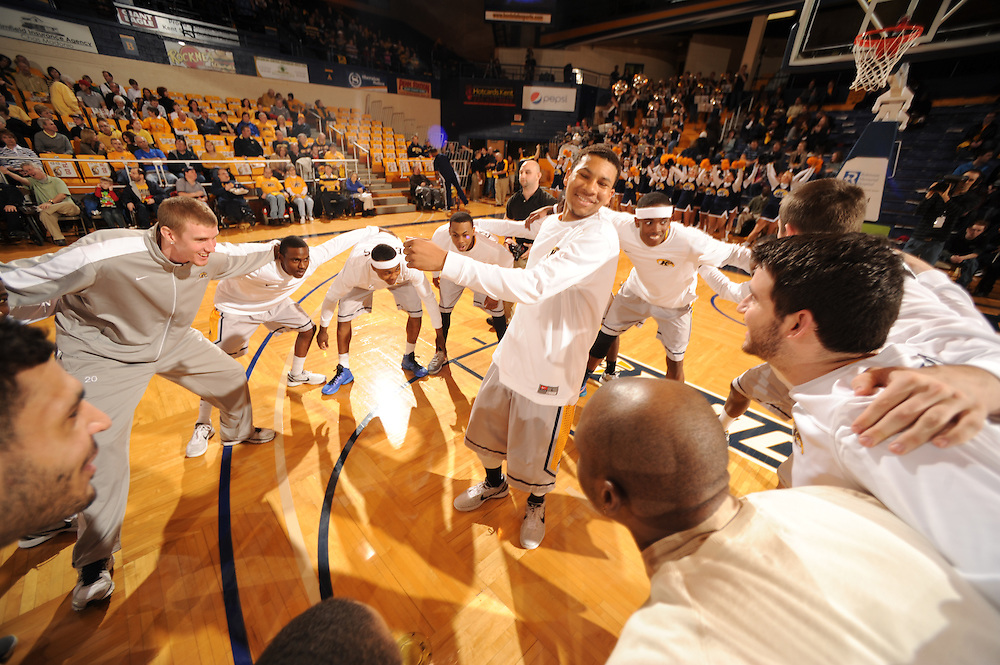 The Golden Flashes basketball team performs a spirit building excercise during pre-game warm ups at the MACC.