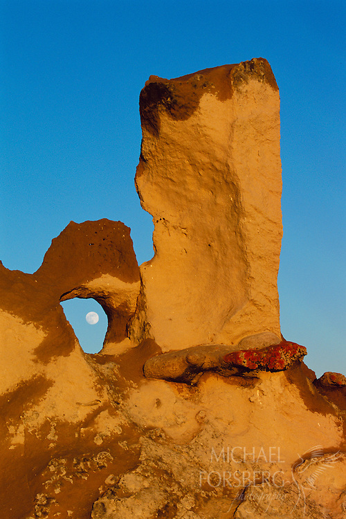 Rocks formations create a peephole for viewing the moon. Sioux County, Nebraska.
