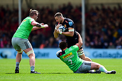Jonny Hill of Exeter Chiefs is tackled by Rob Buchanan of Harlequins - Mandatory by-line: Ryan Hiscott/JMP - 27/04/2019 - RUGBY - Sandy Park - Exeter, England - Exeter Chiefs v Harlequins - Gallagher Premiership Rugby
