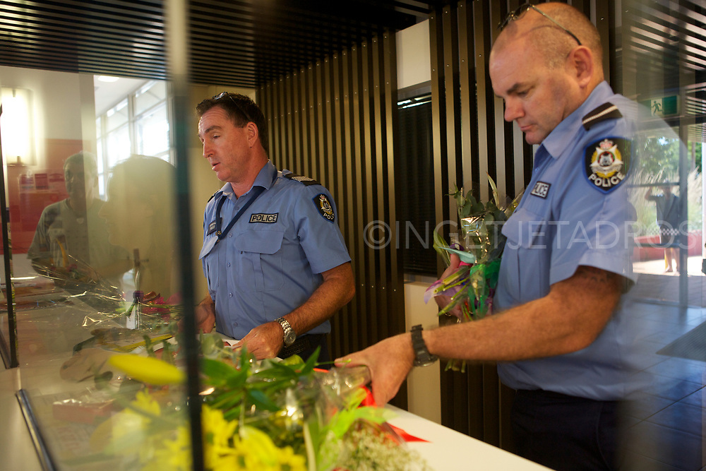 "People offered flowers to the Police Officers inside the police station to give to their mothers. ""We are the families of Broome residents, we are not professional protesters, and we are concerned about what is coming."" Broome, WA"