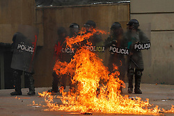 59594097  .Policemen are attacked with a molotov bomb during a protest in commemoration of the International Labour Day in Bogota, capital of Colombia, May 1, 2013,  May 2, 2013 Photo by: i-Images.UK ONLY