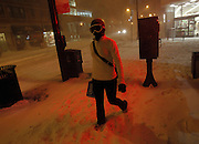 Lauren Kuhlman makes way out of Walgreens in Lakeview with her provisions while wearing ski goggles to fight the blowing snow of a blizzard Tuesday, Feb. 1, 2011.