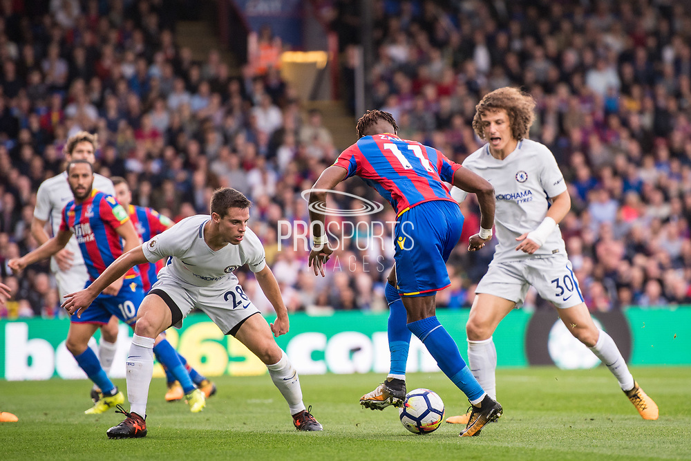 Crystal Palace #11 Wilfried Zaha, Chelsea (28) César Azpilicueta, Chelsea (30) David Luiz during the Premier League match between Crystal Palace and Chelsea at Selhurst Park, London, England on 14 October 2017. Photo by Sebastian Frej.