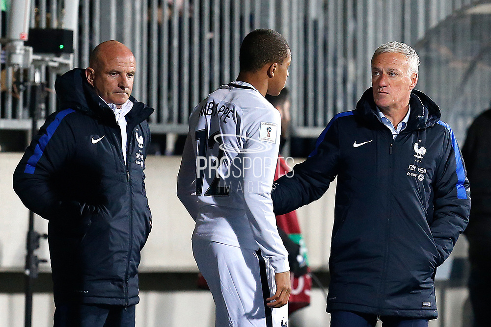 France's coach Didier Deschamps talks to France's forward Kylian Mbappe during the FIFA World Cup 2018 qualifying football match, Group A, between Luxembourg and France on March 25, 2017 at Josy Barthel stadium in Luxembourg - Photo Benjamin Cremel / ProSportsImages / DPPI