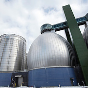 "February 19, 2015 - New York, NY : Three of the Newtown Creek Wastewater Treatment Plant's eight stainless steel-clad ""egg-shaped"" digesters can be seen rising above Greenpoint, Brooklyn. The plant is the largest of New York City's 14 wastewater treatment plants. Bacteria in the digesters break down sludge (organic material removed from sewage) into water, carbon dioxide, methane, and ""digested sludge."" The city burns the methane to create energy and uses the digested sludge as a fertilizer. CREDIT: Karsten Moran for The New York Times"