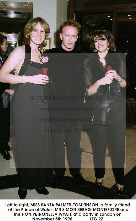 Left to right, MISS SANTA PALMER-TOMKINSON, a family friend of the Prince of Wales, MR SIMON SEBAG-MONTEFIORE and the HON.PETRONELLA WYATT, at a party in London on November 5th 1996.              LTG 22