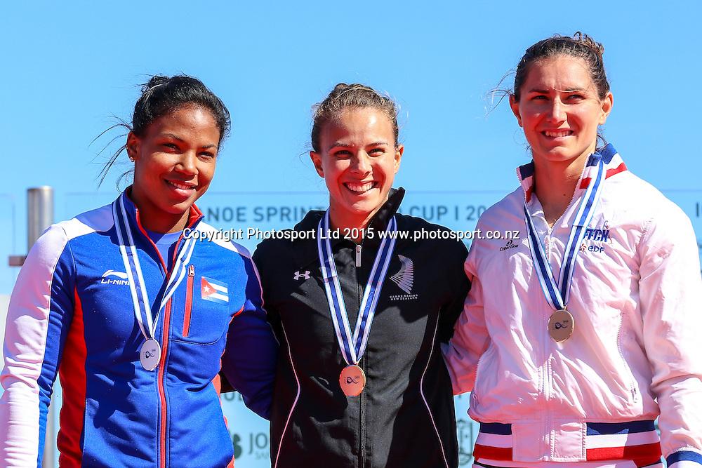 Medalists of the women's K1 200m event (L-R): Yusmari Rodriguez (CUB), Lisa Carrington (NZL), Sarah Guyot (FRA) in Montemor-o-Velho, Portugal at the ICF Canoe Sprint World Cup.