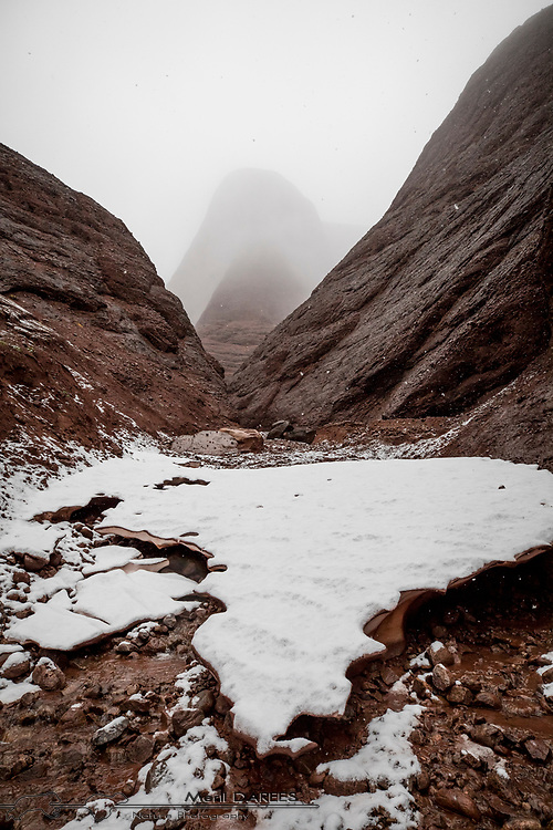 Exploring the red canyons in th Scoresby Sund. Greenland.
