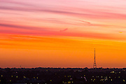 UNITED KINGDOM, London: 13 Jan 2016 The sun starts to rise over one of the two masts of the Crystal Palace transmitting station on yet another beautiful January morning. Rick Findler / Story Picture Agency