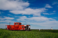 An old CP Rail Caboose sits on the tracks at a siding near Carseland, AB on June 19th, 2007.  Cabooses are no longer in active service for trains in Canada.