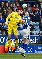 Photo: Steve Bond/Richard Lane Photography. Leicester City v Cardiff City. Coca Cola Championship. 13/03/2010. Paul Gallagher (R) and Mark Kennedy (L) challange in the air