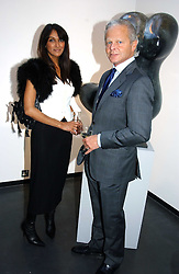 MARK SHANKER and JACKIE ST.CLAIR at a private view of Sculptures by Richard Hudson held at Hamiltons Gallery, 13 Carlos Place, London on 10th May 2005.<br />