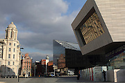 Mishmash of architecture in Liverpool, with a tower of the The Port of Liverpool building on the left and the Museum of Liverpool on the right.