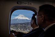 Fuji mountain, January 29 2013 -  Co-workers enjoying the view on Fuji mountain on their way to the west on the bullet train.