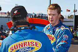 ROSEVILLE, CA - OCTOBER 13: Derek Thorn, driver of the #6 Sunrise Ford/Lucas Oil/Eibach Ford (right) talks to a crew member in the garage during practice for the NASCAR K&N Pro Series West Toyota/NAPA 150 at the All American Speedway on October 13, 2012 in Roseville, California. (Photo by Jason O. Watson/Getty Images for NASCAR) *** Local Caption *** Derek Thorn
