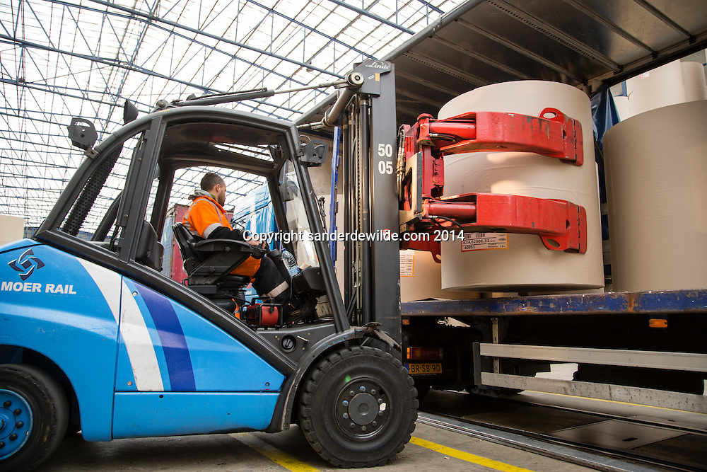 A truck is being loaded with paper at Van Moer Rail stock hall at the port of Antwerp on 8 may 2014