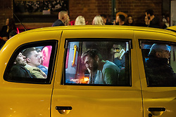 © Licensed to London News Pictures . 28/10/2018. Manchester, UK. Five men share a taxi in the Northern Quarter of Manchester City Centre . Revellers on a night out , many in fancy dress , on the weekend before Halloween . Photo credit: Joel Goodman/LNP